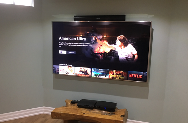 Soundbar Mounted to the Top of the TV