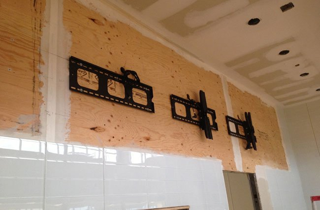 Digital Signage wall mount installation during construction phase