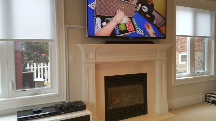 Wire raceway hiding cables for TV mounted above fireplace