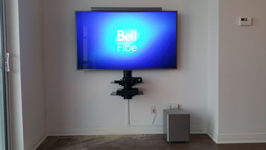 TV, Soundbar & Component Wall Shelf Mounted against Concrete Wall In Condo - Cables Hidden with Raceway