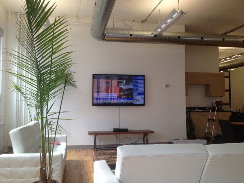 TV Wall mount installation in a Commercial Building with On-wall wire management