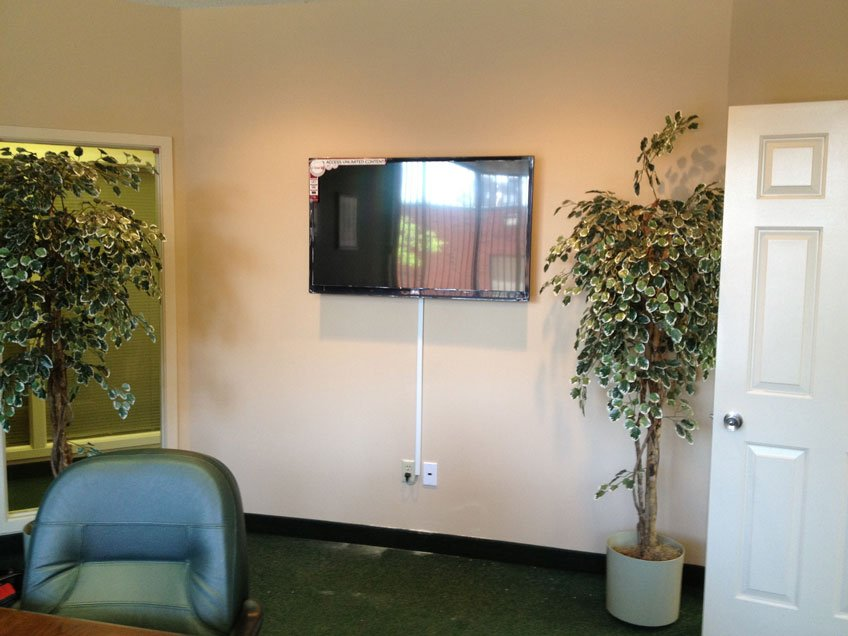 TV wall mounted in office conference room