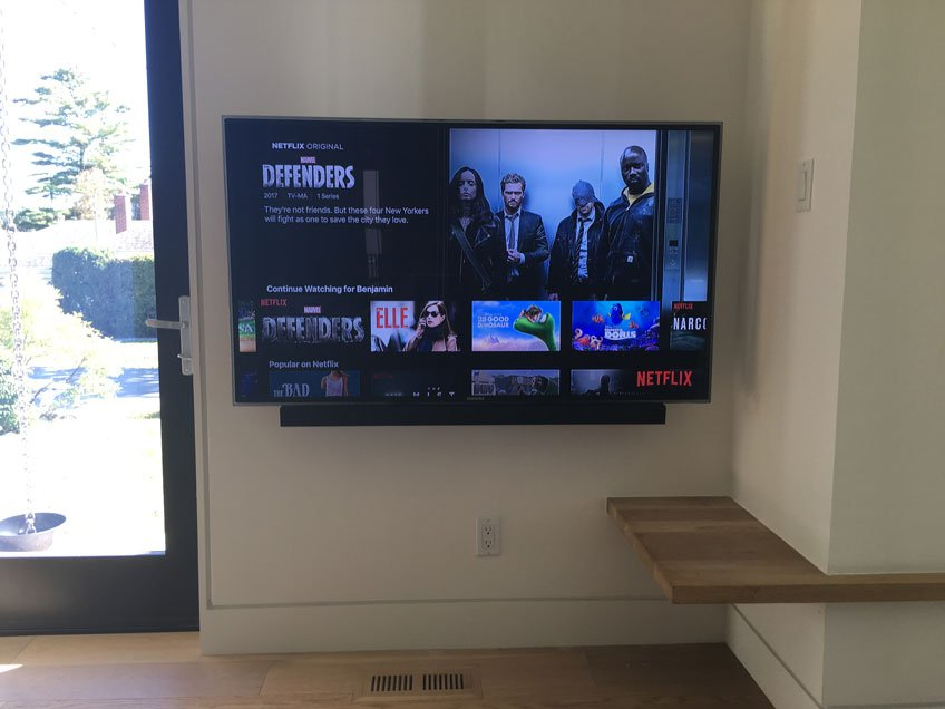 TV & Soundbar pushed back towards the wall