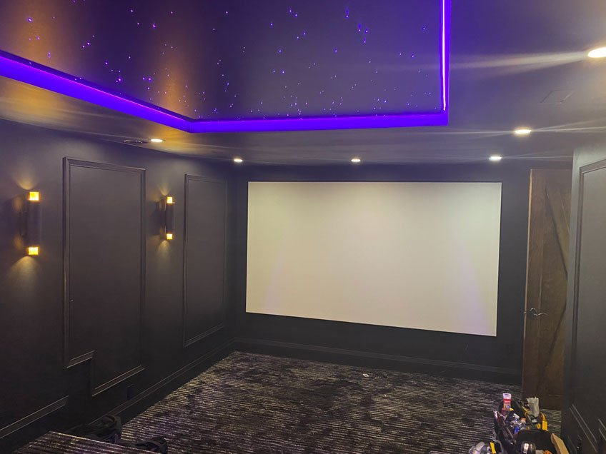 Acoustically Transparent Projector Screen Installed in Front of In-Wall Speakers