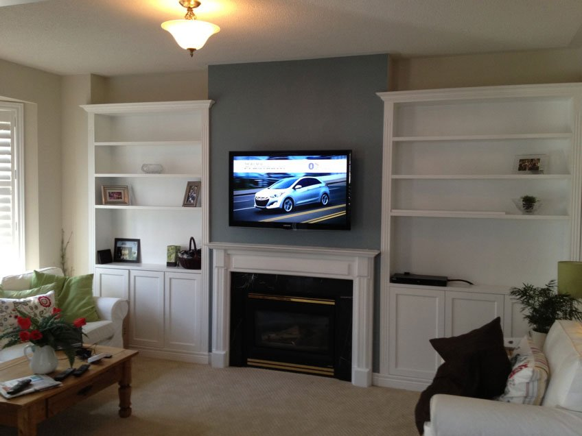 TV wall mounted over fireplace with all wires hidden in the wall