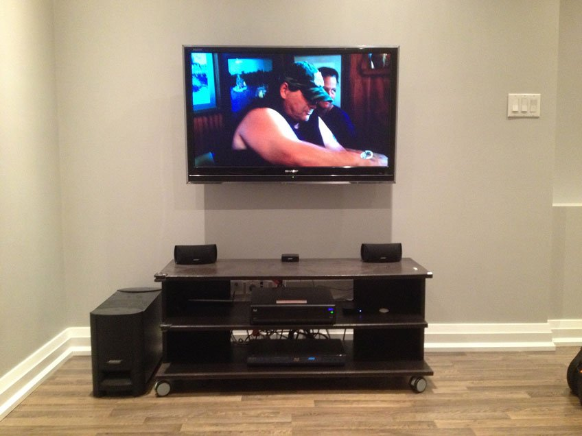 TV wall mounted with wires hidden properly up to building code