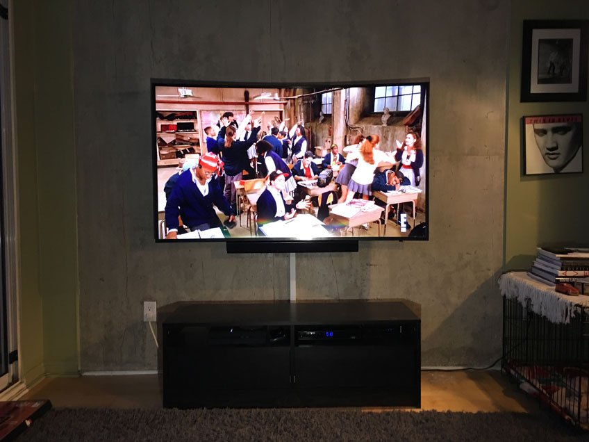 TV & Soundbar Mounted against Exposed Concrete Wall in Loft - Wire hidden with Wire Raceway
