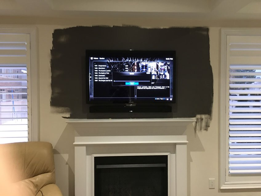 TV & Soundbar wall mounted over fireplace with all wires hidden in the wall