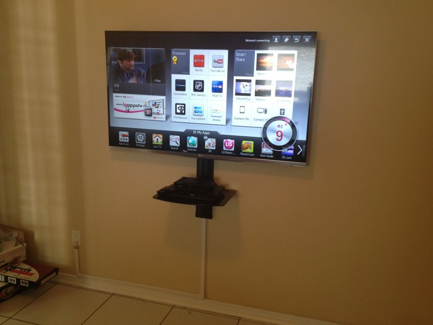 TV and single component shelf installed with wires hidden using wire raceway