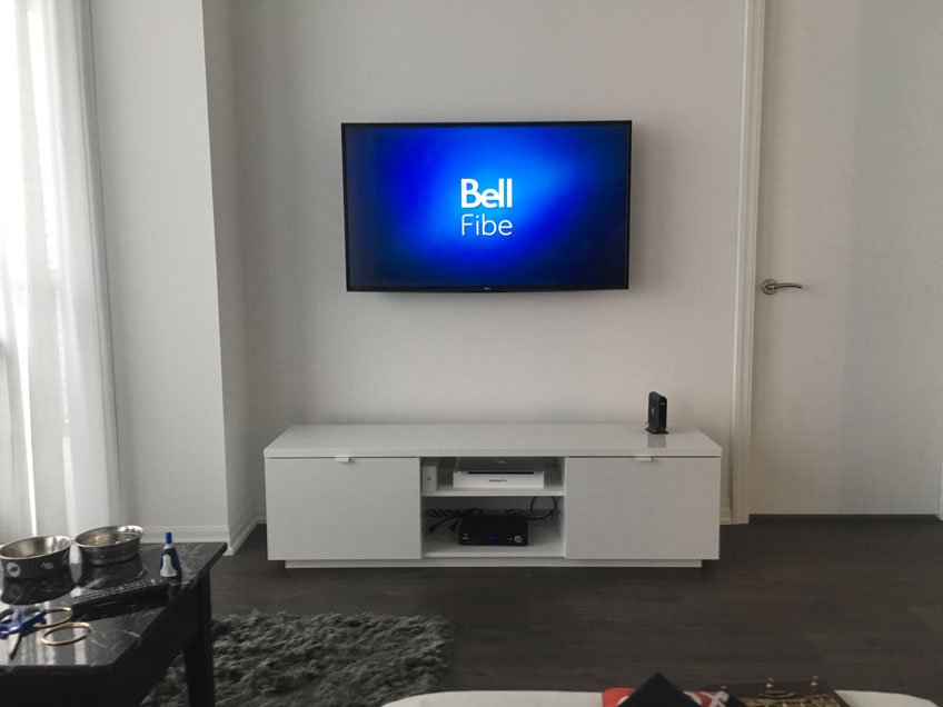 TV wall mounted with all wires hidden up to building code