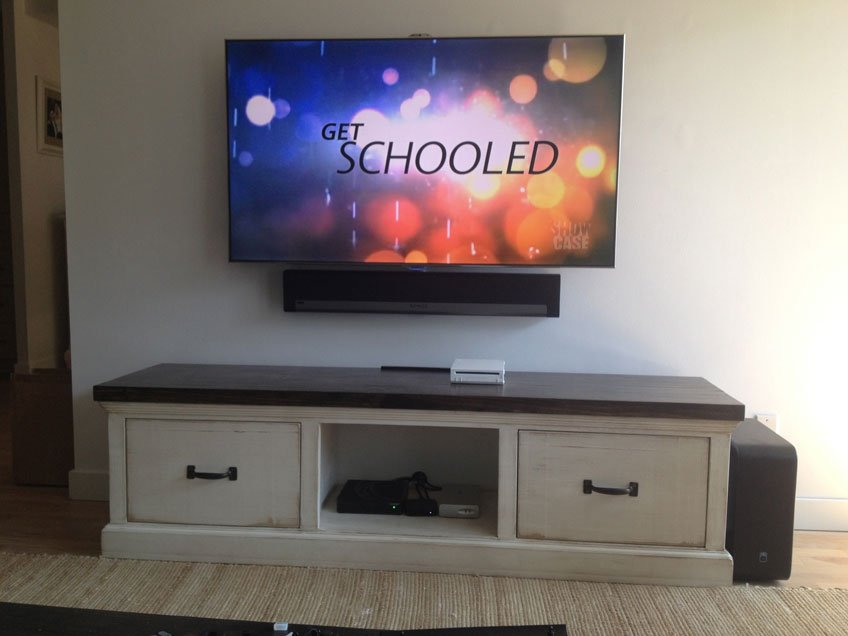 Sonos Playbar wall mounted below the TV