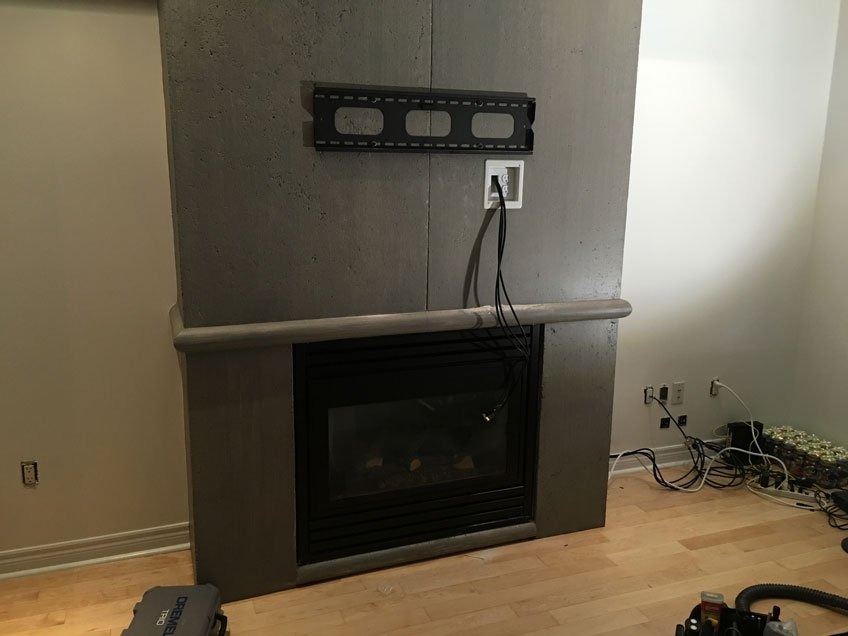 Hiding cables in the wall for TV mounted on protruding fireplace wall