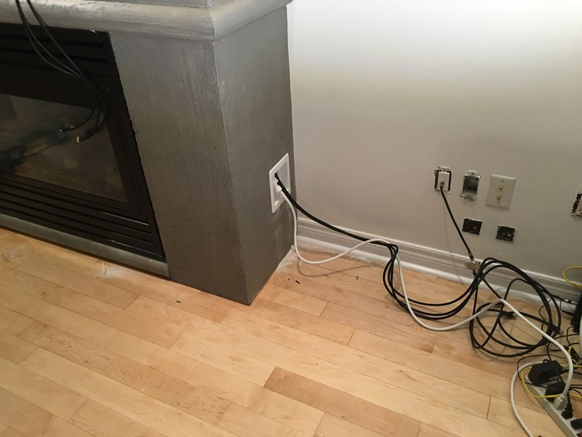 Bridge-Style Power Kit installed to supply power to the TV over fireplace