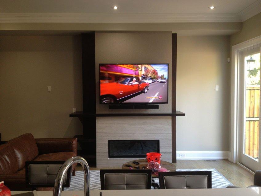 Denon Soundbar mounted below the TV using universal soundbar brackets