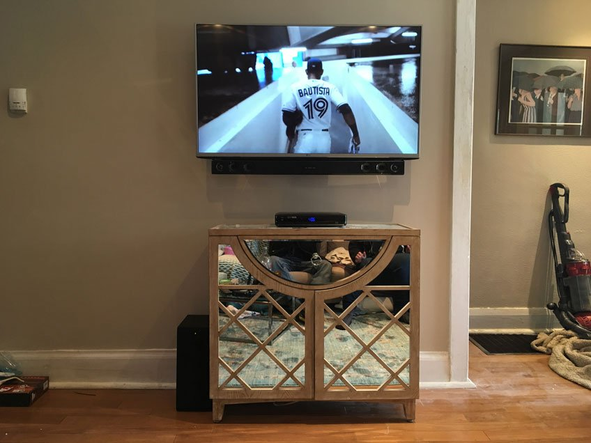 Furniture below the TV hides the Bridge Style Power Kit Inlet