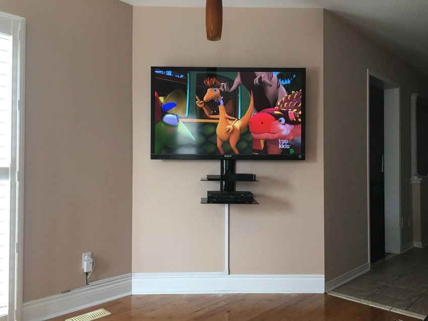 TV and Double Component Wall Shelf wall mounted in a house with wires hidden in wire raceway