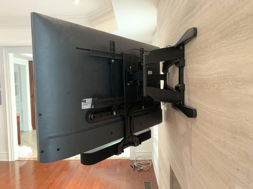 Sonos Beam Soundbar Mounted with Sanus Soundbar Bracket Model WSSBM1 to a Full Motion TV Wall Mount