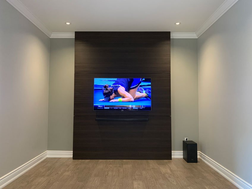 Samsung TV & Soundbar wall mounted with all wires hidden inside hidden compartment behind wood panel