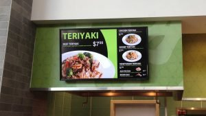 55 inch TV wall mounted as a digital signage display inside of mall food court