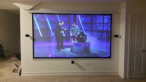 Bose Home theater in basement with projector and projector screen