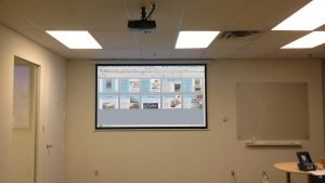 Projector & projector screen installed with all wires hidden in office commercial building