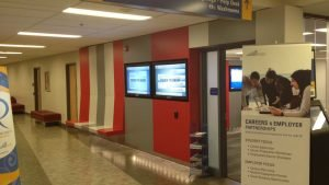 2 x touch-screen display monitors installed in a hallway inside Ryerson university in downtown Toronto - Side view