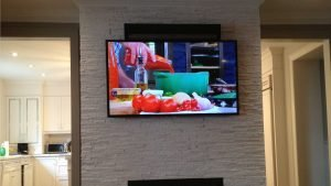 Sonos PlayBar mounted above the TV against custom stone wall