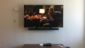 Samsung Soundbar mounted using universal soundbar brackets and attaching to the back of the wall mounted TV