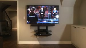 65 inch TV, Soundbar & Component shelf wall mounted in basement room