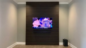 55 inch Samsung QLED TV wall mounted against custom built wall unit with soundbar mounted below