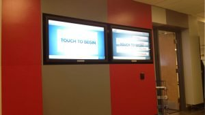 2 x touch-screen display monitors installed in a hallway inside Ryerson university in downtown Toronto