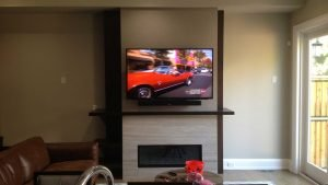 TV and Soundbar wall mounted over fireplace
