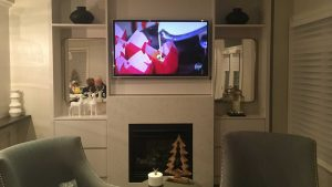 50 inch TV mounted over fireplace with components hidden out of sight controlled by IR repeater