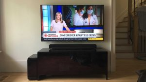 50 inch TV wall mounted with Sonos PlayBar sitting on component stand below