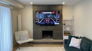 TV & Soundbar Wall Mounted on Tiled Wall Over Fireplace