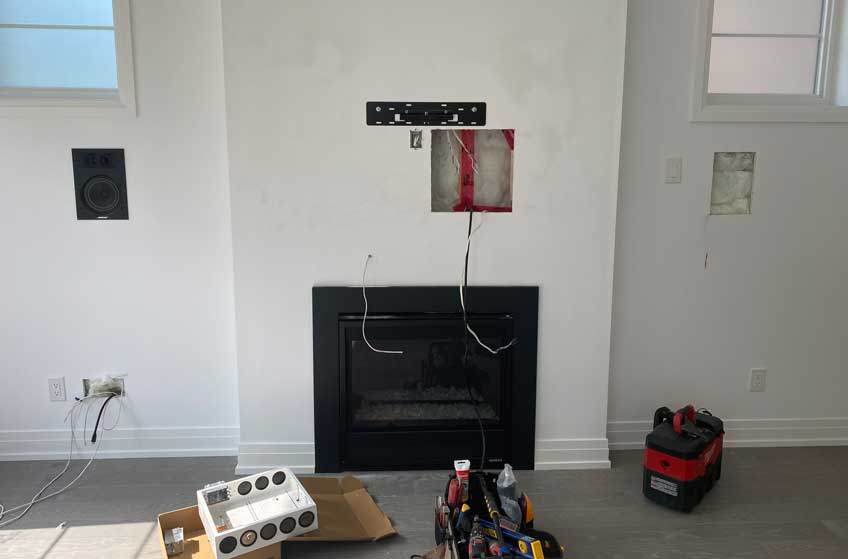 Existing electrical outlet & receptacle box removed to install into AV back box