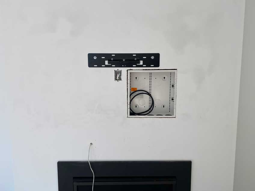 """Example of 14""""x14"""" AV Back Box for in wall storage installed in-wall"""