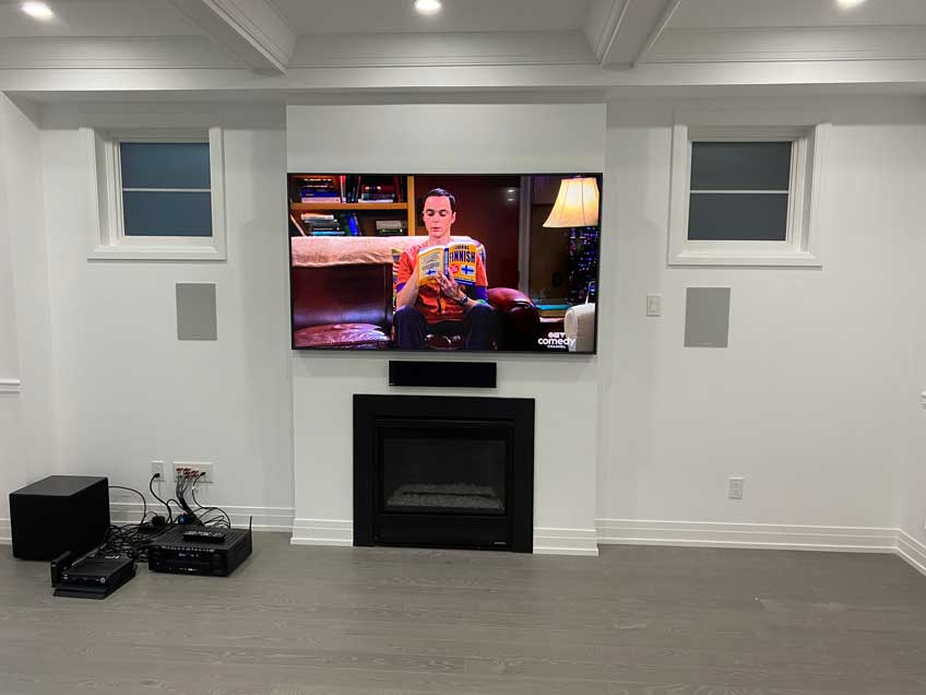 """Samsung Frame TV wall mounted flush against the wall with """"No Gap Wall Mount"""" and One Connect Box hidden inside AV Back Box behind the TV"""