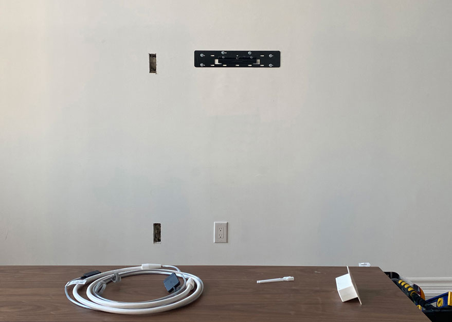 Drywall cut out for Samsung One Connect In-Wall Cable Installation