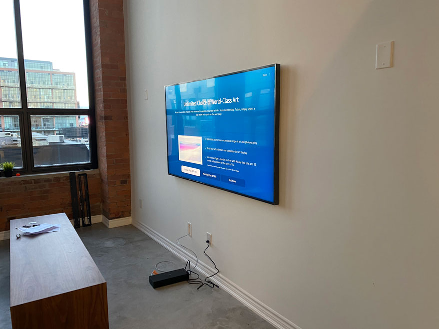 Frame TV wall mounted with One Connect In-Wall cable installed in the wall